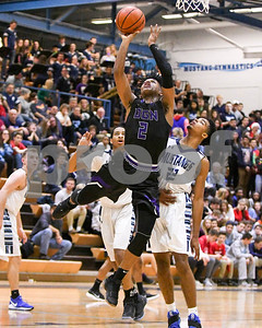 Downers Grove North Semaj Henderson (02)  goes up for a layup during the third quarter while Downers Grove South Wesley Hooker (22)  defends during their game Dec. 16 at Downers Grove South High School. David Toney - For Shaw Media