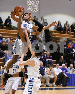Downers Grove South's Wesley Hooker (top), fouls Downers Grove North Semaj Henderson during their game Dec. 16 at Downers Grove South High School. David Toney - For Shaw Media