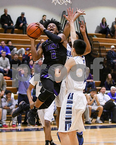 Downers Grove North's Semaj Henderson (02) goes up for a shot during their game against Downers Grove South Dec. 16 at Downers Grove South High School. David Toney - For Shaw Media