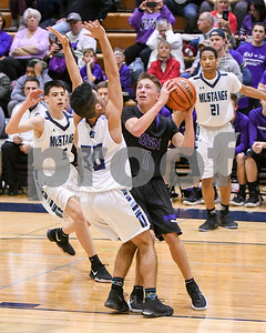 Downers Grove North's Jake Rozema (11) goes up for a shot while being defend by Downers Grove South's Patrick Shaughnessy (30) during their game Dec. 16 at Downers Grove South High School. David Toney - For Shaw Media