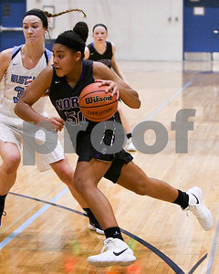 Downers Grove North's Alexis Parker drives to the basket in the fourth quarter of their game against Downers Grove South Dec. 16 at Downers Grove South High School. David Toney - For Shaw Media