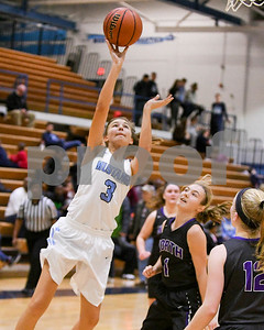 Downers Grove South's Meghan Stapleton goes to the basket during their game against Downers Grove North Dec. 16 at Downers Grove South High School. David Toney - For Shaw Media