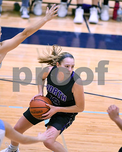 Downers Grove North's Julia Kramper looks for an open teammate during their game against Downers Grove South Dec. 16 at Downers Grove South High School. David Toney - For Shaw Media