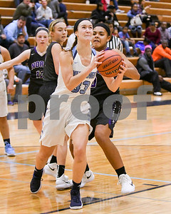 Downers Grove South's Holly Lueken (33) goes up for a shot in the third quarter during their game against Downers Grove North Dec. 16 at Downers Grove South High School. David Toney - For Shaw Media