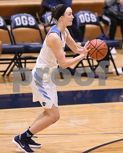 Downers Grove South's Holly Lueken takes a shot during their game against Downers Grove North Dec. 16 at Downers Grove South High School. David Toney - For Shaw Media
