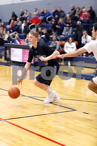 Kevin Enright, a Glenbard South junior, tries to make his way around a defender Friday, Dec. 15, 2017 during their game against IC Catholic Prep.  Sarah Minor - For Shaw Media