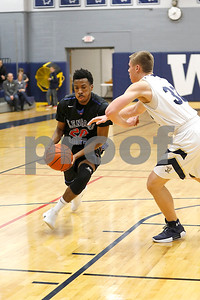 Brandon Whiteside of Glenbard South drives towards the basket Friday, Dec. 15, 2017 during their game against IC Catholic Prep.  Sarah Minor - For Shaw Media