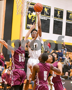 Hinsdale South's Aaron Tims (31)  goes up for a layup in the first quarter during the game against Morton Dec. 7 at Hinsdale South High School in Darien. David Toney - For Shaw Media