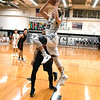 Kaneland Blake Feiza (23) goes up for a layup late in the second quarter Friday agents Yorkville loss.