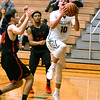 Kaneland Rhett Espe (10) goes up for a layup in the second quarter Friday agents Yorkville.