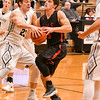 Yorkville Logan Habada (03) goes up for a basket as kaneland Blake Feiza (23) tries to block the shot during the second half of Friday's game. Yorkville wins 46-40