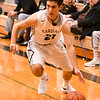 Kaneland Matthew Olson (21)  drives to the basket during Friday's game agents Yorkville.