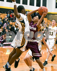 Morton's Jesus Perez (10) goes up for a shot in the fourth quarter as Hinsdale South Kaleb Thomas (02) tries to defend him during their game Dec. 7 at Hinsdale South High School in Darien. David Toney - For Shaw Media