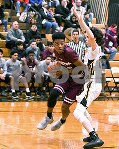 Morton's Stephon Jordan (22) looks for an open teammate as he is defended by Hinsdale South Billy Durkin (10) during their game Dec. 7 at Hinsdale South High School in Darien. David Toney - For Shaw Media