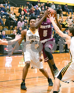 Morton's Latink Murphy (5) drives to the basket during the game against Hinsdale South Dec. 7 at Hinsdale South High School in Darien. David Toney - For Shaw Media