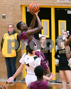 Morton's Latink Murphy (5) makes a basket in the second quarter against Hinsdale South Dec. 7 at Hinsdale South High School in Darien. David Toney - For Shaw Media