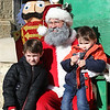 Alex Cluts, 5, left, of Batavia and his brother Isaac, 3, pose for a picture with Santa during a Batavia MainStreet event at Underground Allegro Dance Center in Batavia on Dec. 16.