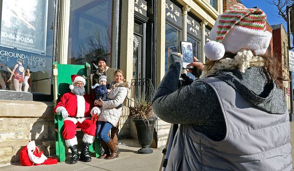 A family poses for a picture with Santa during a Batavia MainStreet event at Underground Allegro Dance Center in Batavia on Dec. 16.