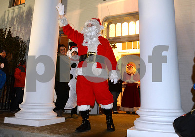 Santa Claus greets visitors as he exits Wilder Mansion Dec. 7 during the annual Tree Lighting at Wilder Park in Elmhurst. Mark Busch - mbusch@shawmedia.com