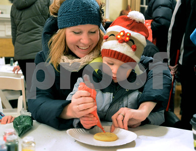 Wyatt McDyer, 2, from Elmhurst, gets a litlle help from his mom Cara while decorating cookies in Wilder Mansion Dec. 7 during the annual Tree Lighting at Wilder Park in Elmhurst. Mark Busch - mbusch@shawmedia.com