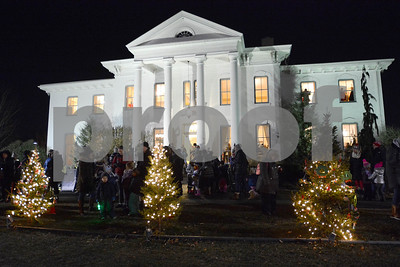 The grounds around Wilder Mansion sparkle after the lights were lit Dec. 7 during the annual Tree Lighting at Wilder Park in Elmhurst. Mark Busch - mbusch@shawmedia.com