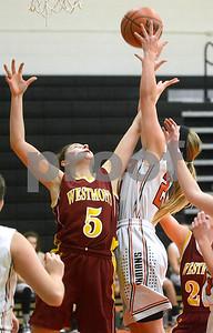 Westmont senior Sydney Pardy and Sandwich sophomore Jaylynn Vana battle for a rebound during their game Dec. 4 at Sandwich High School. Mark Busch - mbusch@shawmedia.com