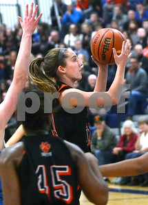 Wheaton Warrenville South's Caitlin Schaughnessy goes to the basket during their game against Wheaton North Nov. 30 at Wheaton North High School. Mark Busch - mbusch@shawmedia.com