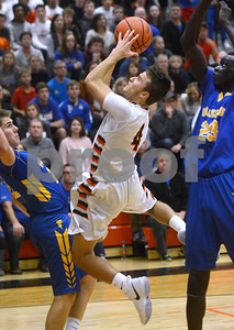 Wheaton Warrenville South senior Jake Healy goes up between two Wheaton North defenders during their game Dec. 1 at Wheaton Warrenville South High School. Mark Busch - mbusch@shawmedia.com