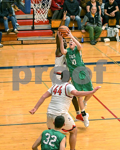 York's Nathan Shockey gets fouled going to the basket during the game against West Aurora Dec. 9 at West Aurora High School. David Toney - For Shaw Media