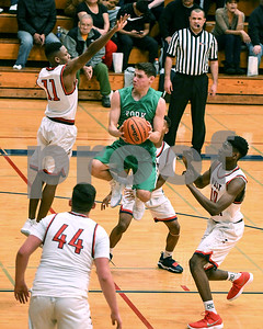 York's Erik Cohn goes up for a shot during the game against West Aurora Dec. 9 at West Aurora High School. David Toney - For Shaw Media