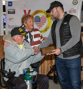 "Anthony ""AJ"" Leopardo (right) from the Leopold Group located in Chicago shakes hands with Viet Nam, Combat Veteran, Ralph Coules at the American Legion Post 491 Saturday, December 1, 2018 in McHenry. Through the efforts of Missy's Veterans of Valor, an organization who helps to fulfill the needs of veterans, Coules received a new electric scooter valued at $4000.00 donated by The Leopardo Group. KKoontz – For Shaw Media"