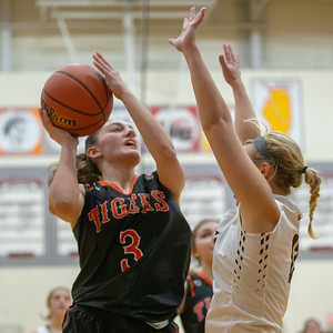 Crystal Lake Central guard Cori Hamill goes up for the shot against Prairie Ridge defender Karly Statter Tuesday, December 4, 2018 in Prairie Grove. Central went on to win the game 48-35 with Hamill finishing with 12 points. KKoontz – For Shaw Media