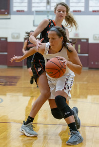 Prairie Ridge's Samantha Gablenz drives past Crystal Lake Central's Nora Ryan in the first quarter Tuesday, December 4, 2018 in Prairie Grove. Gablenz led the Wolves in scoring with nine points in the 48-35 loss to Central. KKoontz – For Shaw Media