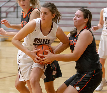Crystal Lake Central's Maddie Haslow fights for the ball against Prairie Ridge's Karsen Karlblom Tuesday, December 4, 2018 in Prairie Grove. Haslow finished leading all scoring with 13 points as Central takes down PR 48-35. KKoontz – For Shaw Media