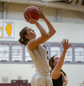 Prairie Ridge guard Karsen Karlblom makes a jumper in the lane against Crystal Lake Central Tuesday, December 4, 2018 in Prairie Grove. Karlblom finished with eight points in the 48-35 loss to Central.  KKoontz – For Shaw Media