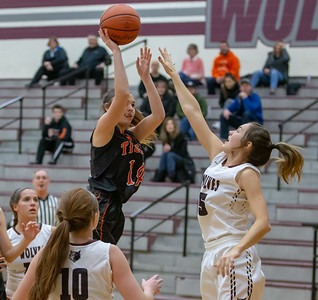 Crystal Lake Central's Lilyann Penza sinks a jump shot over Prairie Ridge's Victoria Fisher Tuesday, December 4, 2018 in Prairie Grove. Central picks up the road win 48-35. KKoontz – For Shae Media