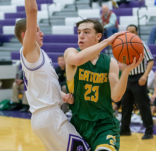 Crystal Lake South's Tyler Miller looks for an open teammate against Hampshire defender Justin Anderson Wednesday, December 5, 2018 in Hampshire. Miller led all scoring on the night with 20 points however Hampshire pulled away late for the win 61-55. KKoontz – For Shaw Media