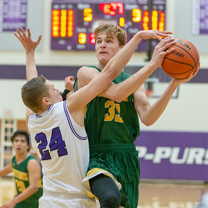 Crystal Lake South's Casey Haskin drives to the basket against Hampshire's Justin Anderson Wednesday, December 5, 2018 in Hampshire. South kept it close most of the game however Hampshire pulled away at the end winning 61-55. KKoontz – For Shaw Media