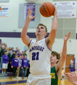 Hampshire's J.D. Shaw gets the rebound and the basket against Crystal Lake South Wednesday, December 5, 2018 in Hampshire. Hampshire went on to take the victory 61-55 with Shaw leading the Whippers finishing with 16 points.  KKoontz – For Shaw Media