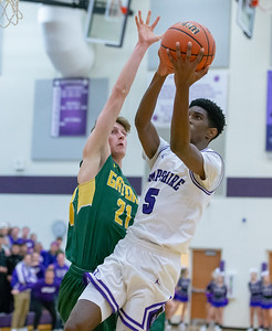 Hampshire's Collin Woods pulls up for the jumper against Crystal Lake South's Matt Reall Wednesday, December 5, 2018 in Hampshire. Hampshire went on to take the victory 61-55. KKoontz – For Shaw Media