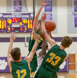 Hampshire's Collin Woods fights through a tough Crystal Lake South defense Wednesday, December 5, 2018 in Hampshire. Hampshire went on to take the victory 61-55. KKoontz – For Shaw Media
