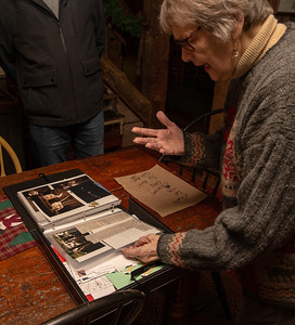 Bev Erikson shows letters and newspaper clippings that they have received and collected over the years from people that have enjoyed their holiday display Thursday, December 6, 2018 in Bull Valley. Peter Messman who lives across Bull Valley road from the Erikson's has joined in as well and now over 200 lighted deer can be seen throughout the holiday season. KKoontz – For Shaw Media
