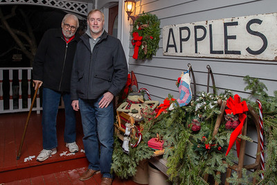 Ken Erikson (Left) and neighbor Peter Messman pose for a photo outside of Erikson's home Thursday, December 6, 2018 in Bull Valley. The two have joined up and now have expanded their holiday display to both sides of Bull Valley road. KKoontz – For Shaw Media