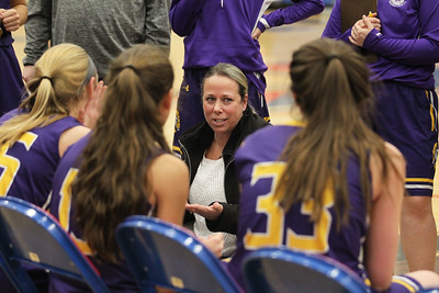 Candace H. Johnson-For Shaw Media Wauconda's Jaime Dennis, head coach, talks with her girls varsity basketball players as they play against Lakes at the end of the first quarter at Lakes Community High School in Lake Villa. Wauconda won 65-64. (12/4/18)