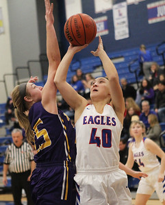 Candace H. Johnson-For Shaw Media Wauconda's Morgan Lung tries to block a shot by Lakes Mia Urban in the first quarter at Lakes Community High School in Lake Villa. Wauconda won 65-64. (12/4/18)