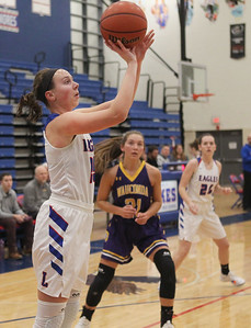 Candace H. Johnson-For Shaw Media Lakes Kyle Jozwik aims for the hoop past Wauconda's Allie Tylka in the first quarter at Lakes Community High School in Lake Villa. Wauconda won 65-64. (12/4/18)