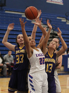 Candace H. Johnson-For Shaw Media Lakes Mia Edwards (#22) attempts to pull down a rebound against Wauconda's Kiley Szmajda and Jessie Pakaski in the second quarter at Lakes Community High School in Lake Villa. Wauconda won 65-64. (12/4/18)