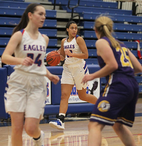 Candace H. Johnson-For Shaw Media Lakes Mia Edwards (center) drives to the basket with Taylor Lehman against Wauconda's Morgan Lung in the second quarter at Lakes Community High School in Lake Villa. Wauconda won 65-64. (12/4/18)