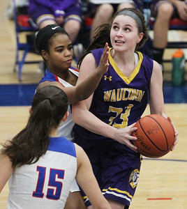 Candace H. Johnson-For Shaw Media Wauconda's Kiley Szmajda (#33) looks up for a shot against Lakes Sara Smith and Brittany Washington in the third quarter at Lakes Community High School in Lake Villa. Wauconda won 65-64. (12/4/18)