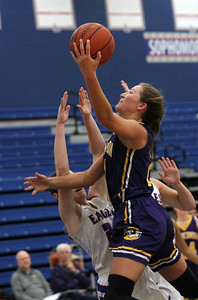 Candace H. Johnson-For Shaw Media Wauconda's Allie Tylka puts up a shot over Lakes Taylor Lehman and Kylie Jozwik in the fourth quarter at Lakes Community High School in Lake Villa. Wauconda won 65-64. (12/4/18)